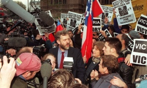 Corbyn speaking to journalists outside the Commons after the historic ruling by the House of Lords against the appeal of former Chilean dictator Augusto Pinochet in 1998.